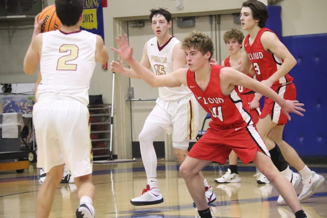 McLoud's Jacob Jordan (24) guards Byng's Dylan Reed (2) during Thursday morning action at the First United Bank Classic at Bethel High School.