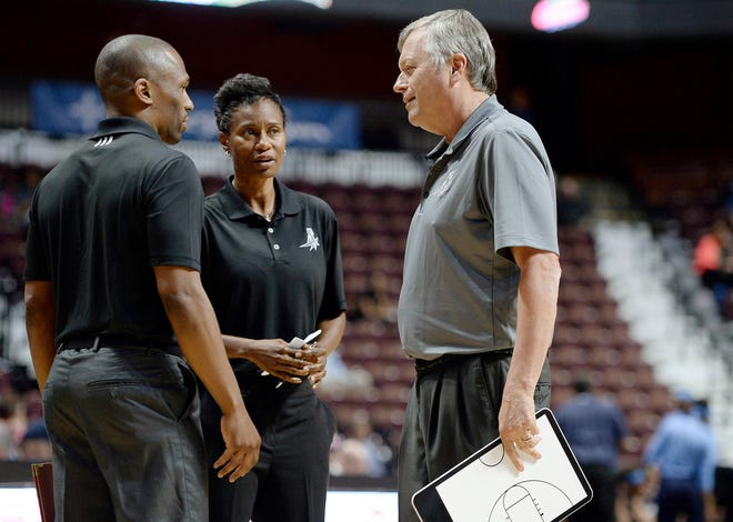 San Antonio Stars coach Dan Hughes talks with assistant coaches James Wade, left, and Vickie Johnson, center, in a 2016 file photo. Johnson has agreed in principle to be the next coach of the Dallas Wings.