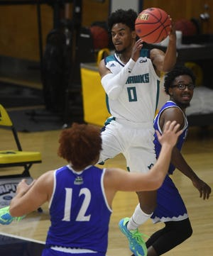 UNCW guard Ty Gadsden saves the ball against St. Andrews at Trask Coliseum Wednesday, December 9, 2020. This was the first home game of the season for the men's team.   [MATT BORN/STARNEWS]