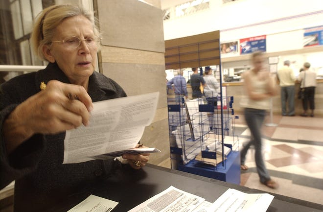 Muriel Stewart of Wilmington looks over a tax extension form at the main branch of the Post office on Front Street.