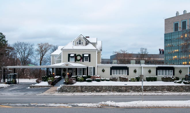 Mercadante Funeral Home, 370 Plantation St., Worcester, has expanded over the years, amid a changing neighborhood. The arched upper window on the house is one of the giveaways when comparing the old and new photographs.