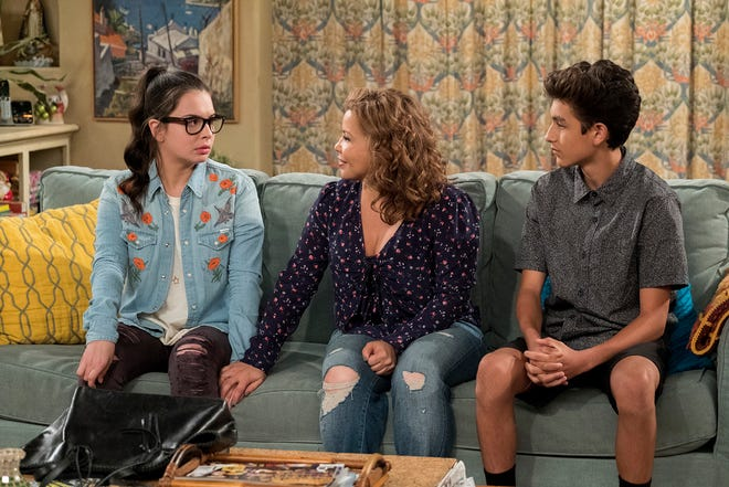 """Isabella Gomez as Elena, Justina Machado as Penelope and Marcel Ruiz as Alex in """"One Day at a Time."""""""