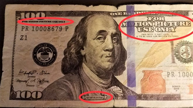 This $100 bill states in the top left and right corner that the money is for motion picture use only.