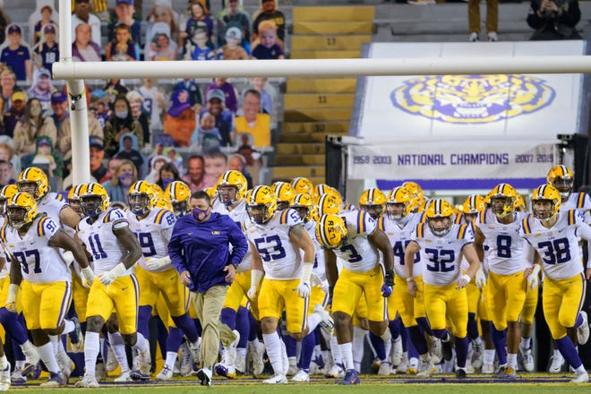 LSU head coach Ed Orgeron leads his team on the field before the game against Alabama in Baton Rouge, La., last Saturday.