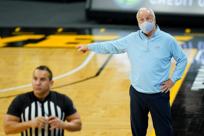 North Carolina coach Roy Williams points out instructions during Tuesday night's game at Iowa.