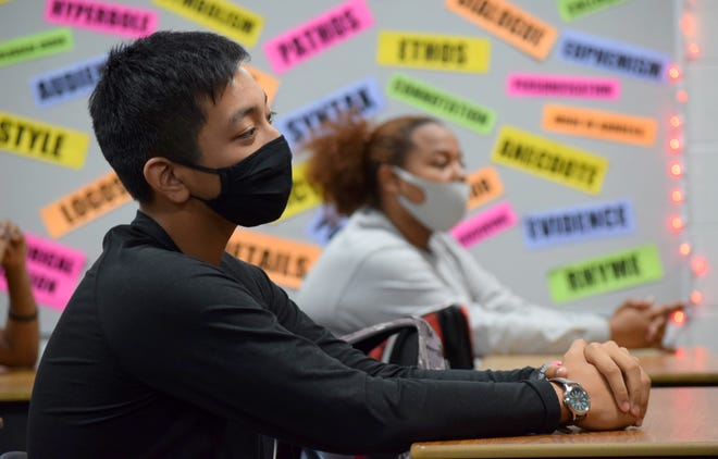 To prevent the spread of COVID-19, Bay High School students wear face masks and socially distance while in classrooms.
