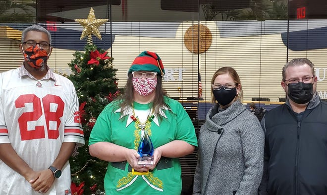 April Darling (second from left) was named winner of the 2020 Mel Clemens Community Service Award on Dec. 7 during a City Council meeting. Councilman Stacie Baker (left) made the presentation which also was attended by two of Clemens' children, Melodi Slater and Shane Clemens.