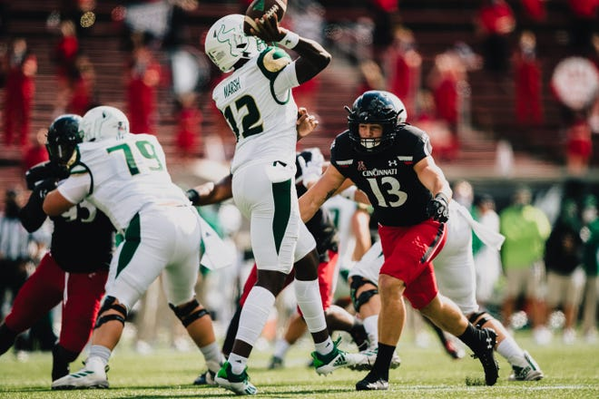 Ty Van Fossen (13), a DeSales graduate, has been a key player for Cincinnati, which will be looking for its third consecutive bowl victory under DeSales graduate and coach Luke Fickell.