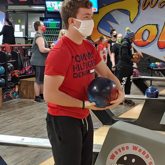 Groveport Madison junior Hunter Rathburn prepares to take a shot during practice Dec. 9 at Wayne Webb's Columbus Bowl. Rathburn was the Cruisers' top scorer last year with a 184.7 average.