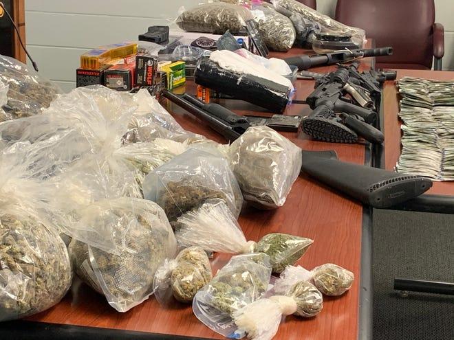 Marijuana, cocaine, guns and money seized in a Hamilton drug investigation Wednesday.