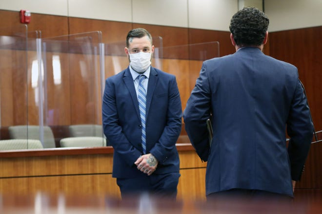 Chef Chad Barrett stands at his arraignment shortly after pleading no contest to charges of domestic abuse, second offense, in Macomb County 42nd District Court in New Baltimore on November 9, 2020.