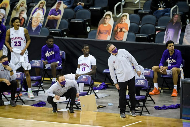 University of Evansville Head Coach Todd Lickliter and the Aces' bench watches a shot go in during the home opener against the Eastern Illinois University Panthers at Ford Center in Evansville, Ind., Wednesday, Dec. 9, 2020. The Purple Aces defeated the Panthers 68-65, marking the team's first victory in 354 days.
