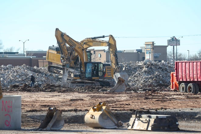 Demolition works continues at the site where Forest Mall once stood on West Johnson Street. A tax incremental financing district created by the city will  help finance redevelopment of the property.