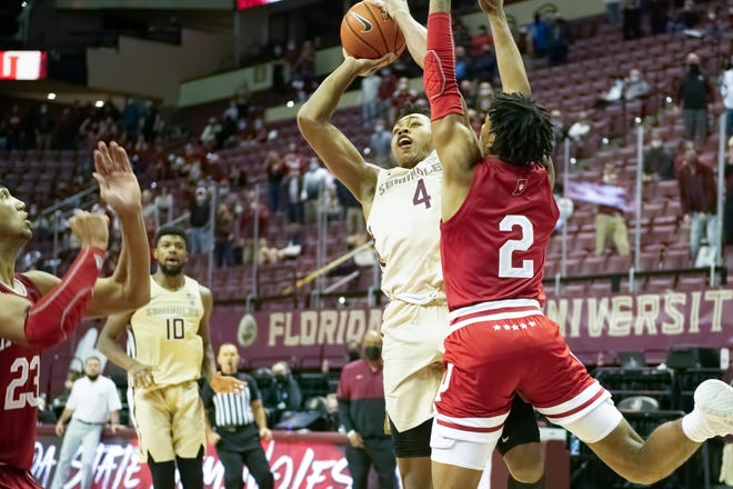 FSU freshman guard Scottie Barnes (4) drives into the lane to hit a game-winning shot as Hoosiers sophomore guard Armaan Franklin (2) guards during the ACC-Big Ten Challenge in Tallahassee, FL., Wednesday, Dec. 9, 2020.