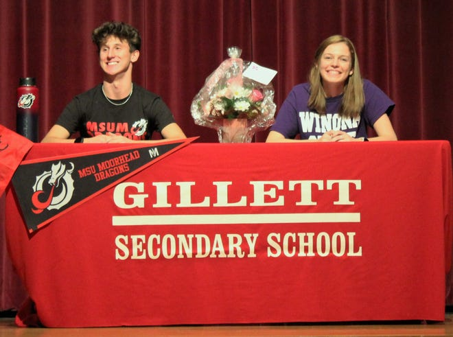 Gillett seniors Derek Hanson and Sylvia Hansen smile for family, friends and classmates on Nov. 30 after signing letters of intent to attend Minnesota State University Moorhead and Winona State University, respectively, and compete in both cross country and track.