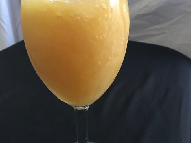 The brandy slush is a super sweet cocktail of orange, lemon and brandy flavors.