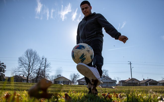Criso Sanchez dribbles his soccer ball Christian Park in Indianapolis on Thursday, Dec. 10, 2020. Sanchez says he uses soccer to get moving and stay healthy.