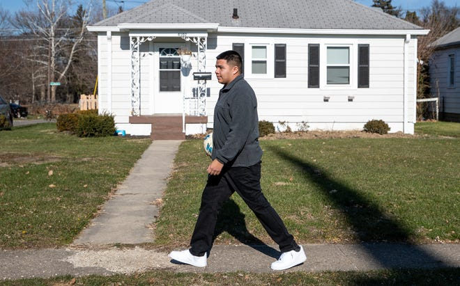 Criso Sanchez carries his soccer ball to Christian Park in Indianapolis on Thursday, Dec. 10, 2020.