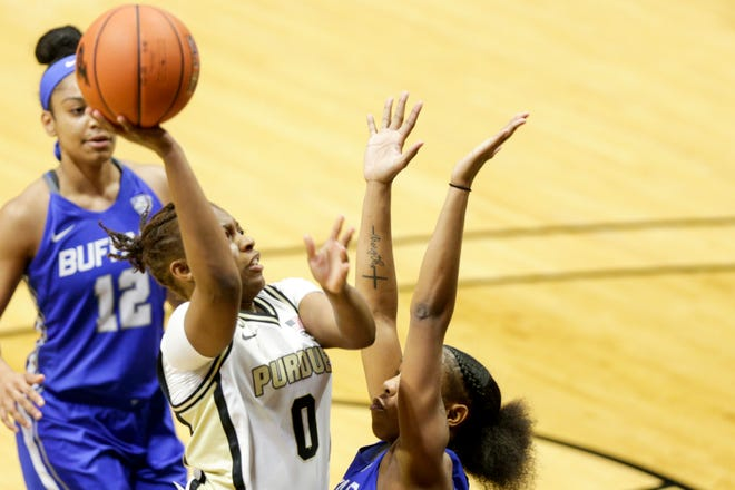 Purdue guard Brooke Moore (0) goes up for a layup during the first quarter of an NCAA women's basketball game, Wednesday, Dec. 9, 2020 at Mackey Arena in West Lafayette.
