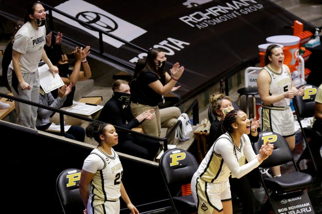 The Purdue bench reacts to a basket during the third quarter of an NCAA women's basketball game, Wednesday, Dec. 9, 2020 at Mackey Arena in West Lafayette.