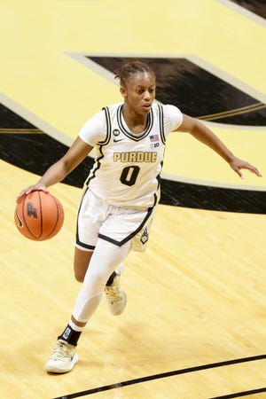 Purdue guard Brooke Moore (0) dribbles during the second quarter of an NCAA women's basketball game, Wednesday, Dec. 9, 2020 at Mackey Arena in West Lafayette.