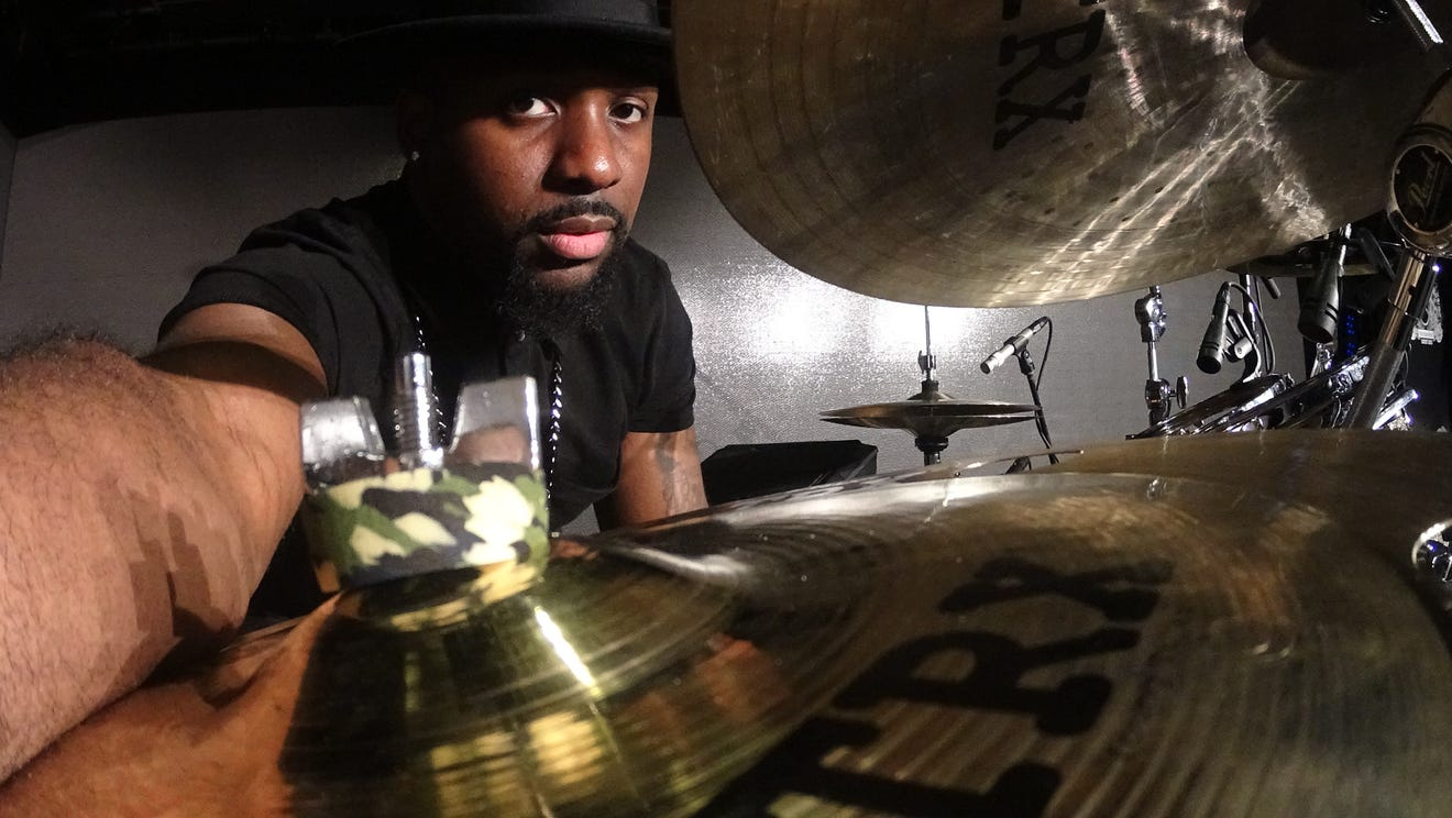 Lansing native Josh Baker joined Mariah Carey's tour group in 2014 after accepting a drumming position for a TODAY Show appearance.