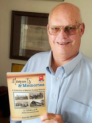"""Randy Winland, of Marion, recently published his fourth book, """"Moments and Memories: A Collection of Marion County History."""" The bookcovers a wide range of topics including insights into the history of the villages and communities of Marion County, agriculture, business, education, entertainment, health care, industry, religion, and sports."""