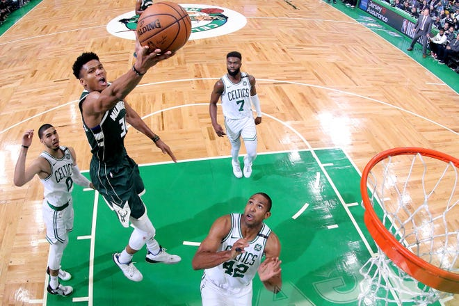 Giannis Antetokounmpo takes a shot over Boston's Al Horford during the 2019 Eastern Conference semifinals.