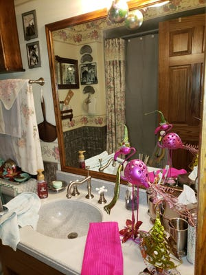 Flamingos and ornaments adorn the bathroom at the Williams home.