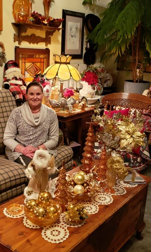 Marsha Williams finds a spot among the decorations in the family room.