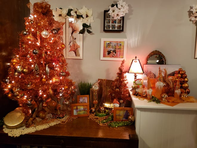 """An orange tree and other items are in the """"orange room"""" in the basement. Orange is Marsha Williams' favorite color, and the room is used for entertaining."""
