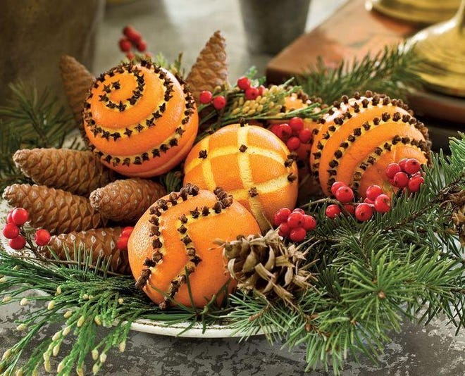 Orange pomanders ornaments not only look festive, they leave a cheerful odor of citrus and cloves.
