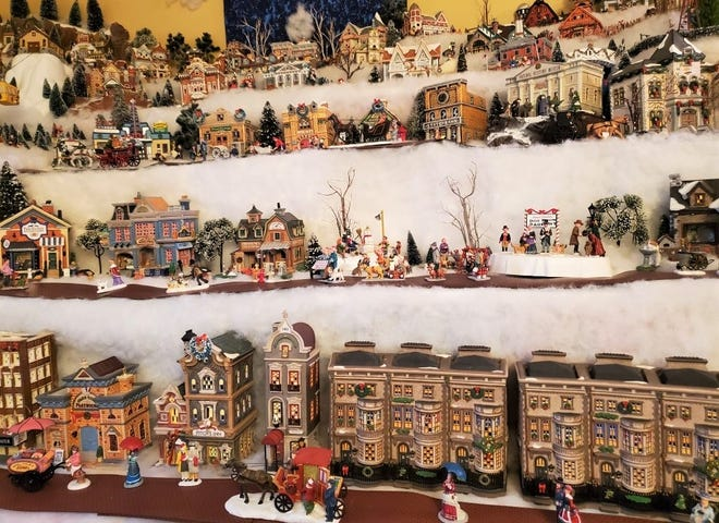 Corey said her Christmas Village collection takes up the living room of her Livonia home.