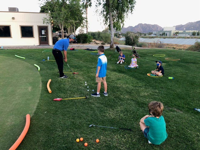First Tee uses hula hoops to give kids a boundary they can visualize for social distancing,