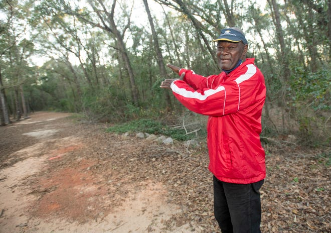 Richard Whatley points out the course of the new cross country trail that he has help develop at the Pensacola State College - Milton Campus in Milton on Wednesday, Dec. 9, 2020.