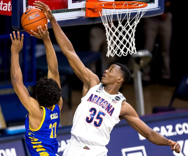 Arizona Wildcats center Christian Koloko (35) blocks Cal State Bakersfield Roadrunners guard Justin McCall's (22) shot during the second half of the Arizona Wildcats vs Cal State Bakersfield Roadrunners men's basketball game at McKale Center, 1721 E. Enke Dr., in Tucson, Ariz. on Dec. 9, 2020.