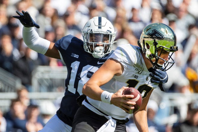 Purdue quarterback Jack Plummer (13) is sacked by Penn State defensive end Shaka Toney (18) during an NCAA college football game in State College, Pa., on Saturday, Oct. 5, 2019. (AP Photo/Barry Reeger)