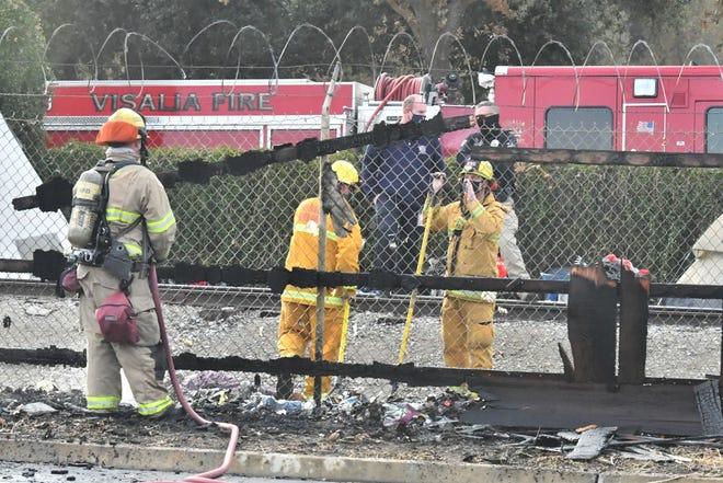 A homeless encampment along a railroad near Mary's Vineyard caused a trash fire that scorched Visalia Kia's fence, authorities said.