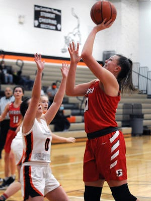 Faith Stinson, of Sheridan, takes a shot during the Generals' 67-43 win against host New Lexington on Wednesday night.