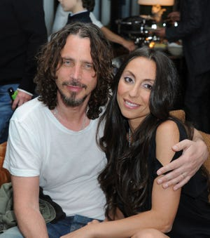 Chris Cornell, at left, and his wife, Vicky Karayiannis.