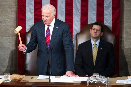 Vice President Joe Biden, with House Speaker Paul Ryan of Wis., right, watching, delcares that Congress certifies Donald Trump's presidential victory during a joint session of Congress, on Capitol Hill in Washington, Friday, Jan. 6, 2017.