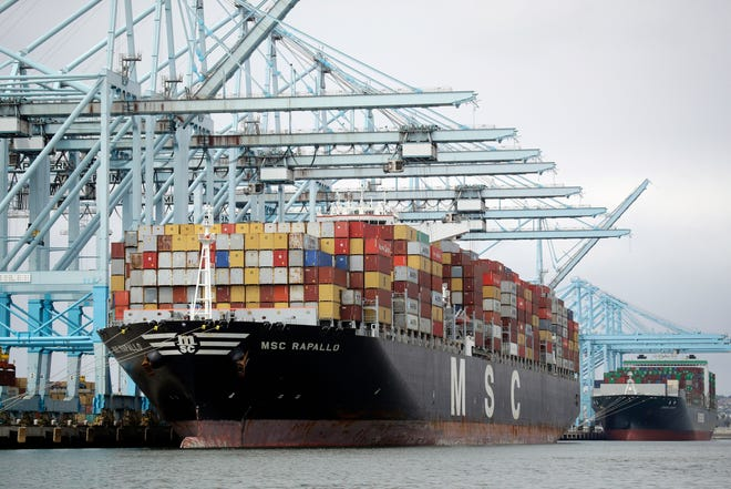 A cargo ship is docked at the Port of Los Angeles, in Los Angeles on June 19, 2019.