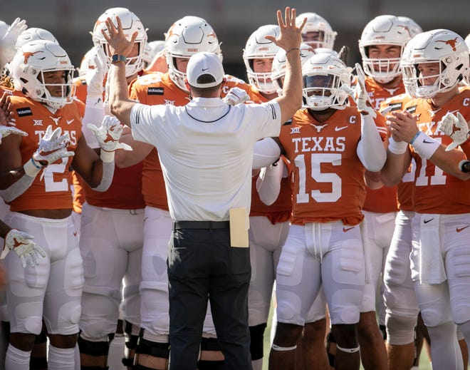 Texas head coach Tom Herman talks to his team during warmups for the Nov. 7 game against West Virginia. Herman, nearing the end of his fourth season in Austin, has been the focus of rumors about his job for the past few weeks.