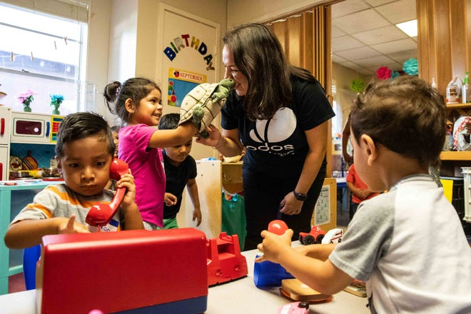 Emma Lopez plays with Christina Collazo as Yurel Gomora, Ricardo Lopez and Anthony Arallano are around them in a classroom during the Todos Juntos program in 2019.