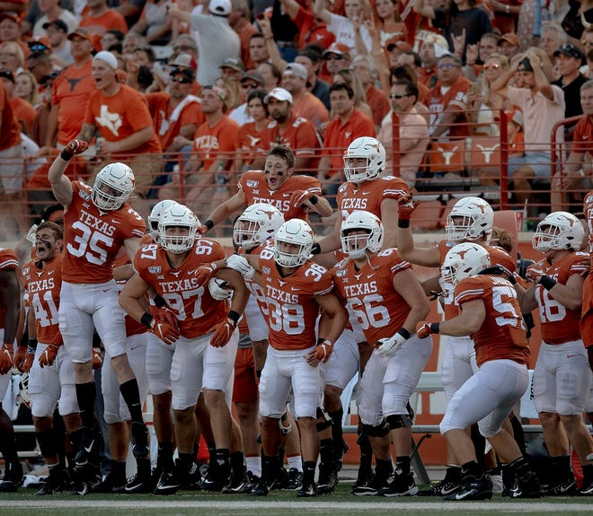 Texas players get rowdy on the sideline for a kickoff against Louisiana Tech on Aug. 31, 2019 in Austin.