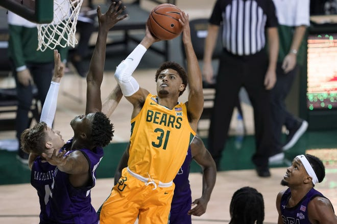 Baylor guard MaCio Teague takes a shot over Stephen F. Austin's Nana Antwi-Boasiako, left front, David Kachelrie, left rear, and DeAndre Heckard, right, during the Bears' victory on Dec. 9 in Waco. The Bears open Big 12 play on Sunday against Texas.