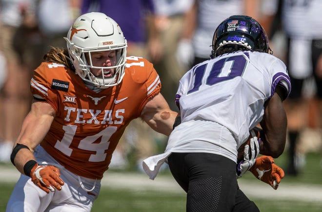 Texas receiver Brenden Schooler tries to tackle TCU's JD Spielman on a kickoff return at Royal-Memorial Stadium on Oct. 3, 2020.