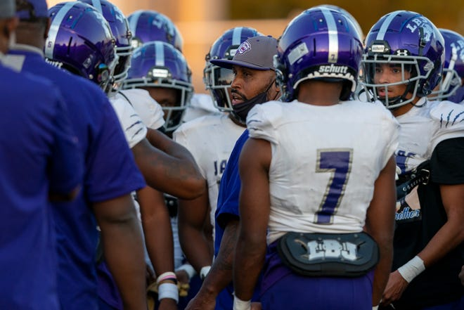 LBJ head coach Jahmal Fenner speaks with his team before a high school football game at Manor ISD Athletic Complex earlier this year. The Jaguars face Lindale in a Class 4A Division I state semifinal in Humble on Friday.