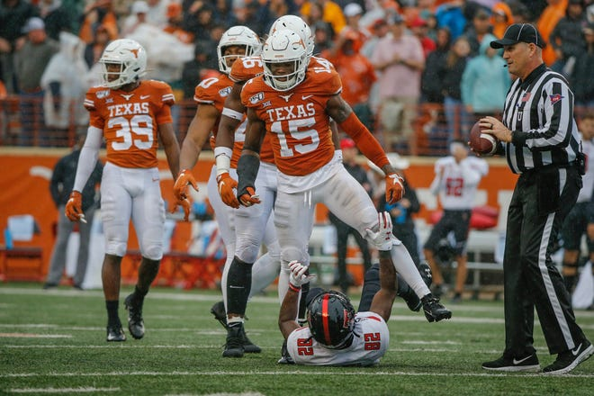 Texas defensive back Chris Brown gets up after making a tackle on Texas Tech wide receiver KeSean Carter in the fourth quarter against Texas Tech at Darrell K. Royal Texas Memorial Stadium Nov. 29, 2019. [JAMES GREGG/AMERICAN-STATESMAN]