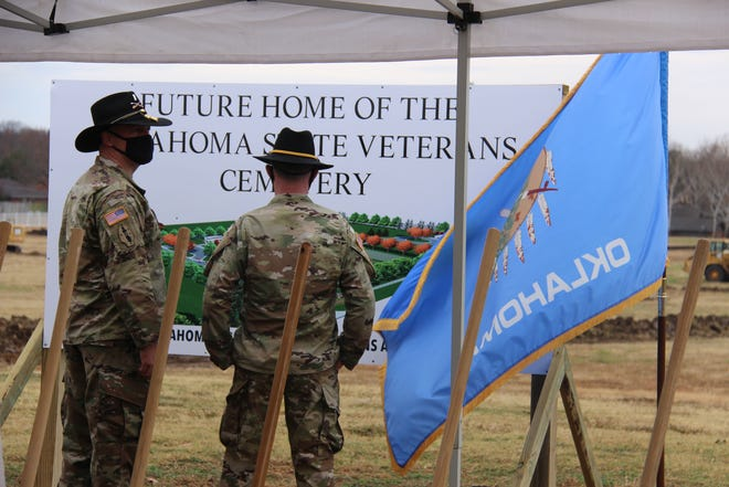 Members of the 180th Cavalry Regiment observe the plans for the new Oklahoma Veterans Cemetery during a groundbreaking ceremony on Dec. 11.